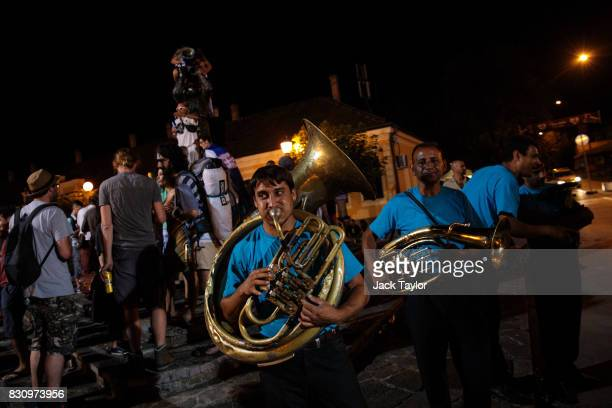 A brass band plays to revellers in the town centre during the Guca Trumpet Festival in the early hours on August 10 2017 in Guca Serbia Thousands of...