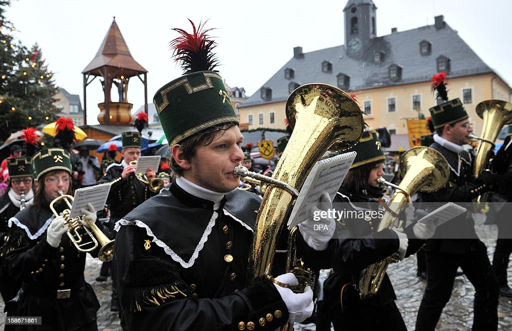 A brass band wearing traditional miners costumes take part in a christmas miners parade in Annaberg-Buchholz, eastern Germany, on December 23, 2012.The miners' parade is traditionally held in places in Germany where ore was smelted. OUT