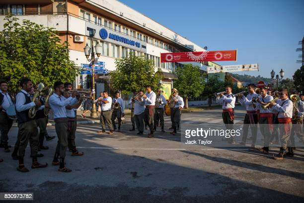 Brass bands play in the streets for the wakening call of the trumpeters during the Guca Trumpet Festival on August 11 2017 in Guca Serbia Thousands...