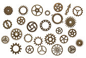 Many old brass, clockwork cog wheels isolated on white background