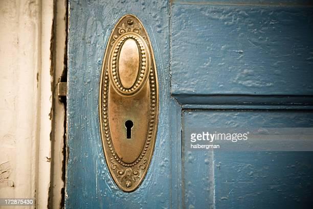 Brass Doorknob on a Blue Door