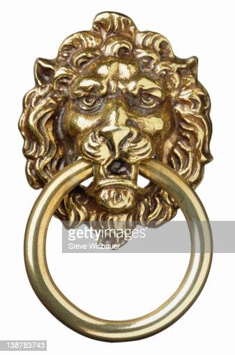 A brass lion's head door knocker