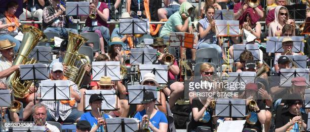 Brass musician play during the final mass of the Kirchentag festival celebrating the 500th anniversary of the Reformation at a meadow near the river...