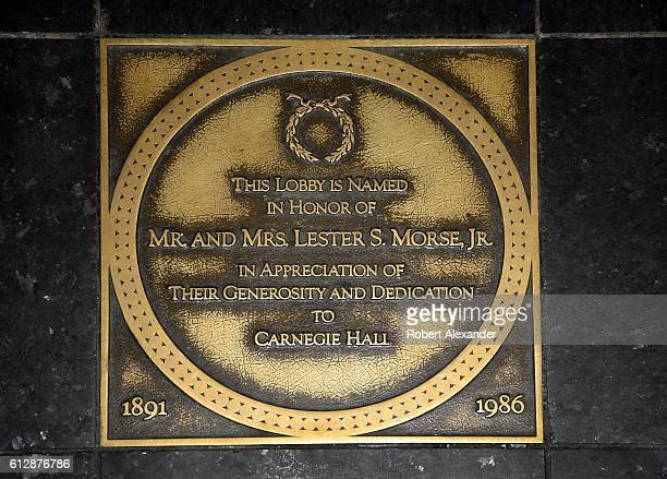 A brass plaque embedded in the floor of the lobby at Carnegie Hall in New York City acknowledges the financial support given the historic concert...