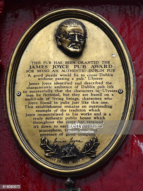 A brass plaque mounted on the exterior wall of a Dublin Ireland pub identifies it as the recipient of the James Joyce Pub Award 'for being an...