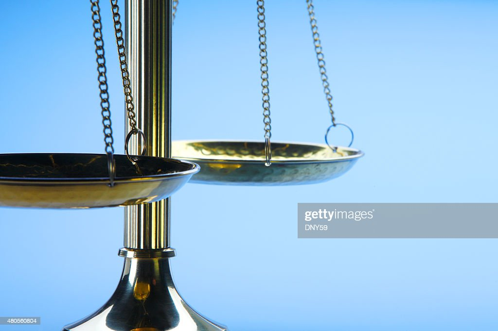 Brass Scales Of Justice On A Blue Background : Stock Photo