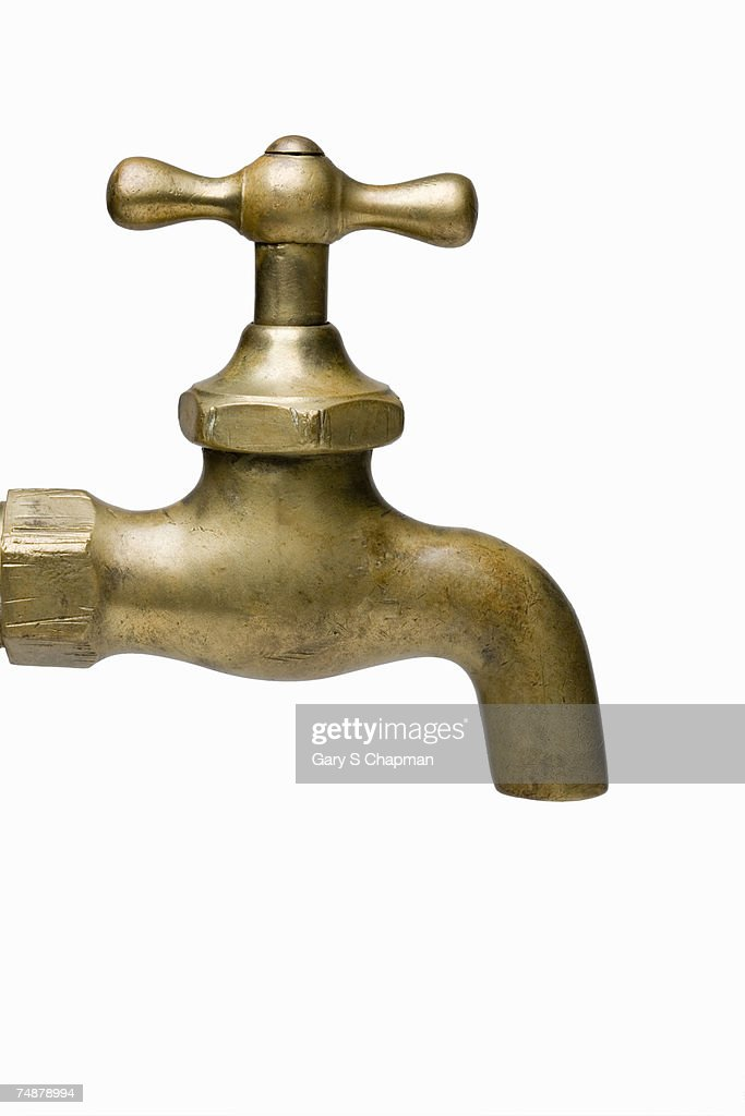 Brass water faucet on white background, close-up : Stock Photo