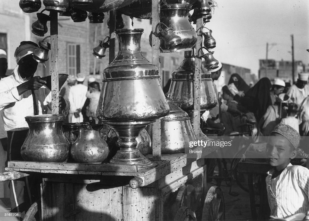 A brassworkers handcart with brass jugs and vases in Port Said Egypt