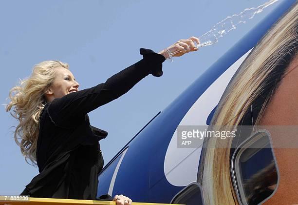 Slovak born international top model Adriana Sklenarikova Karembeu christens with champagne Eastern Europe's lowcost low fare airline SkyEurope's new...