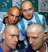Slovakia's Davis cup players Dominik Hrbaty Karol Kucera Karol Beck and Michal Mertinak pose with freshly shaved heads during the press conference...