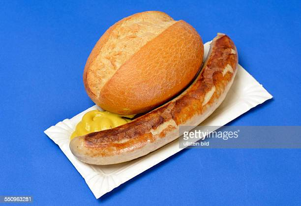 A bratwurst / fried sausage with mustard and a bread roll