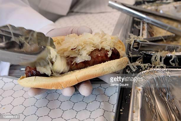 Bratwursts are prepared before Super Bowl XLV at Cowboys Stadium on February 6 2011 in Arlington Texas