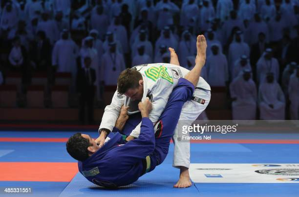 Braulio Estima of Brazil competes with Paulo Jardin of Brazil in the Men's black belt 94 kg finals during the Abu Dhabi World Professional JiuJitsu...