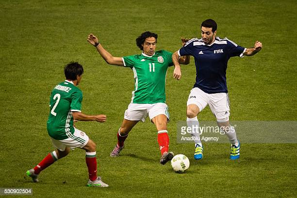 Braulio Luna of Mexican allstar team in action against Mohamed Aboutrika of FIFA Football Legends team during a friendly match between Mexican...