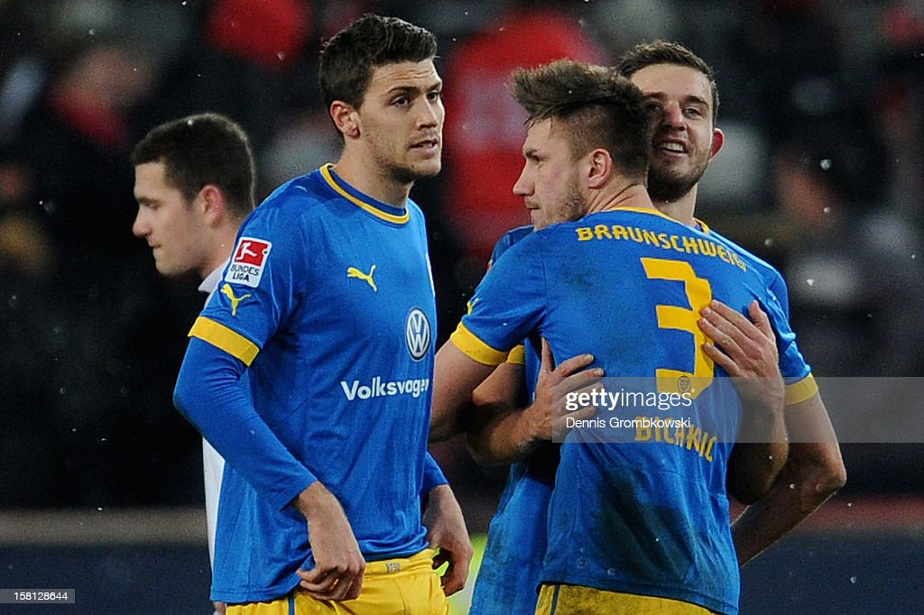 Braunschweig players celebrate after the Bundesliga match between 1. FC Koeln and Eintracht Braunschweig at RheinEnergieStadion on December 10, 2012 in Cologne, Germany.