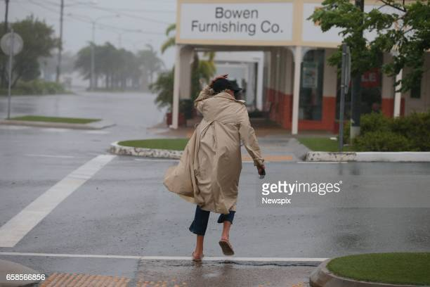 BOWEN QLD A brave local battles the wind before the worst of tropical cyclone Debbie hits in Bowen Queensland