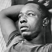Braves' Hank Aaron relaxes in Braves' clubhouse after celebration and hoopla following Atlanta's clinching of National League Western division flag...