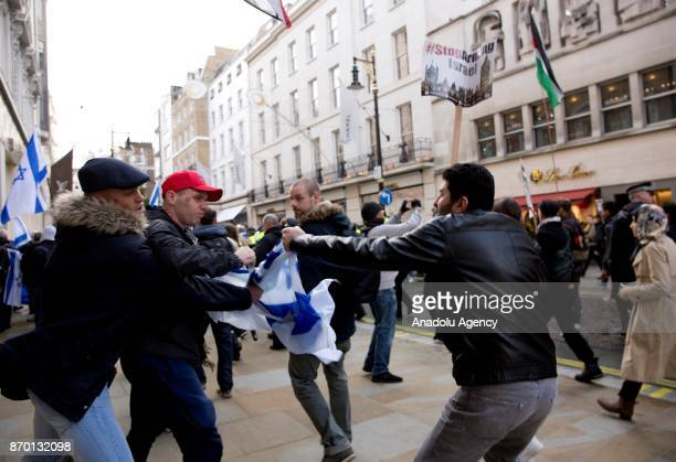 Brawl breaks out between Israeli protesters and proPalestinian supporters during a national march through central London England on November 4 2017...