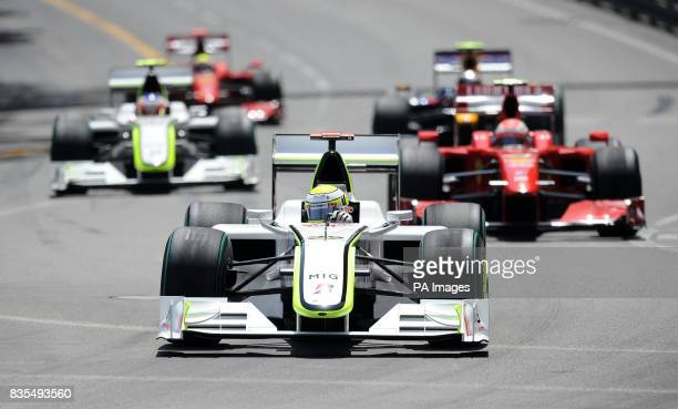 Brawn GP's Jenson Button leads into the first corner from Ferrari's Kimi Raikkonen and team mate Rubens Barrichello during Monaco Grand Prix at the...