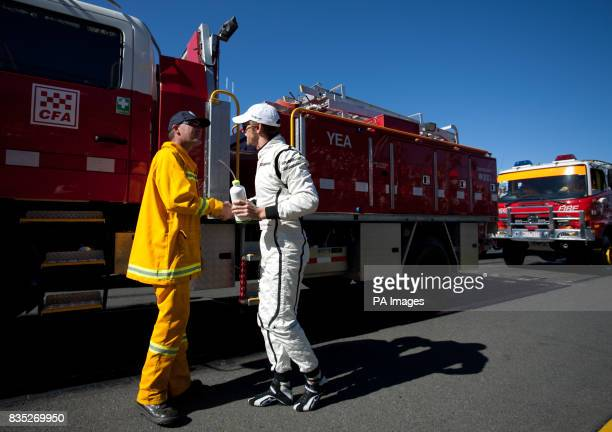 Brawn GP's Jenson Button thanks CFA fireman during the Australian Grand Prix at Albert Park Melbourne Australia