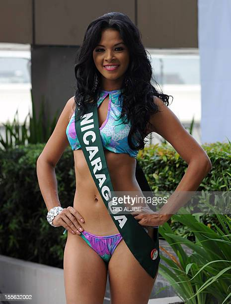 Braxis Alvarez of Nicaragua poses for photographers during a press presentation of the Miss Earth beauty pageant at a hotel in Manila on November 6...