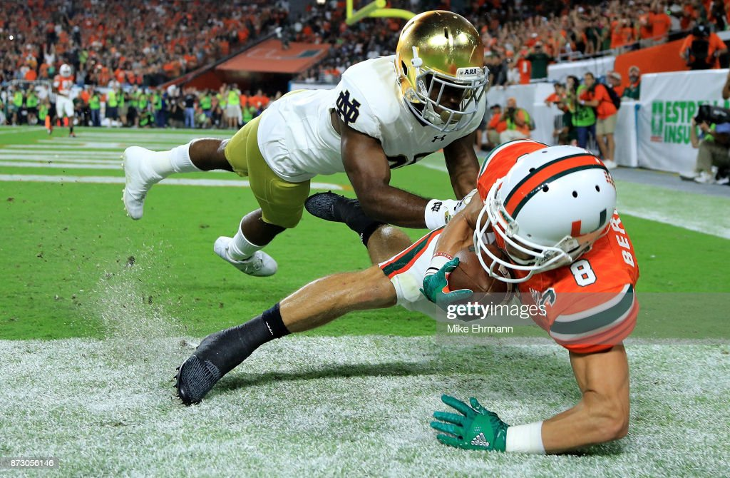 Braxton Berrios #8 of the Miami Hurricanes scores a touchdown during a game against the Notre Dame Fighting Irish at Hard Rock Stadium on November 11, 2017 in Miami Gardens, Florida.