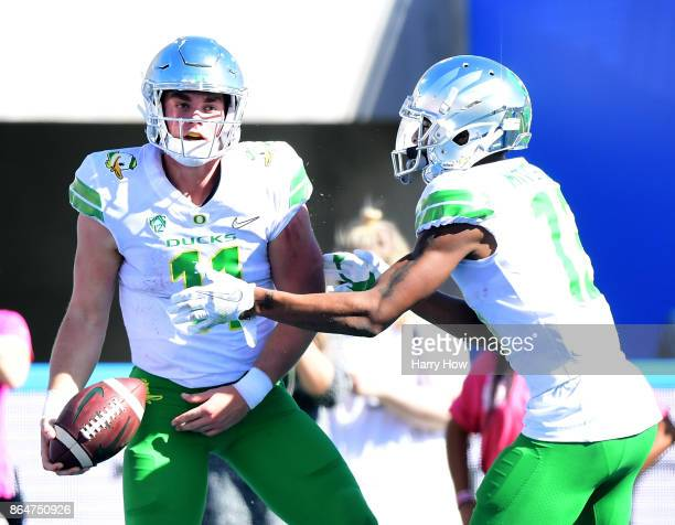 Braxton Burmeister of the Oregon Ducks celebrates his touchdown run with Dillon Mitchell to trail 147 to the UCLA Bruins during the first half...