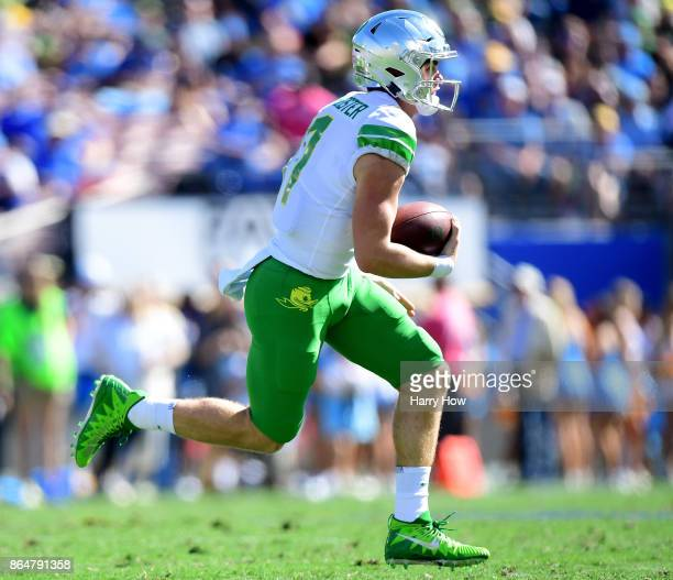 Braxton Burmeister of the Oregon Ducks scrambles out of the pocket during the first half in a 3114 loss to the UCLA Bruins at Rose Bowl on October 21...