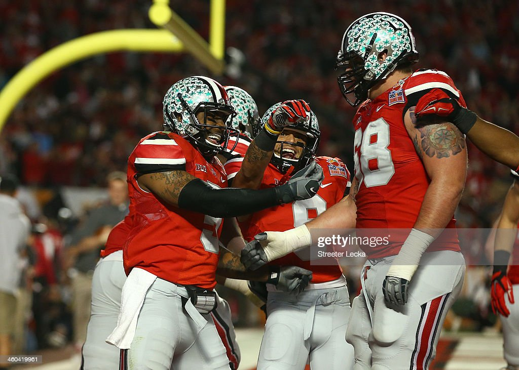 <a gi-track='captionPersonalityLinkClicked' href=/galleries/search?phrase=Braxton+Miller&family=editorial&specificpeople=7122480 ng-click='$event.stopPropagation()'>Braxton Miller</a> #5, Devin Smith #9 and Taylor Decker #68 of the Ohio State Buckeyes celebrate after a touchdown by Miller in the second quarter against the Clemson Tigers during the Discover Orange Bowl at Sun Life Stadium on January 3, 2014 in Miami Gardens, Florida.