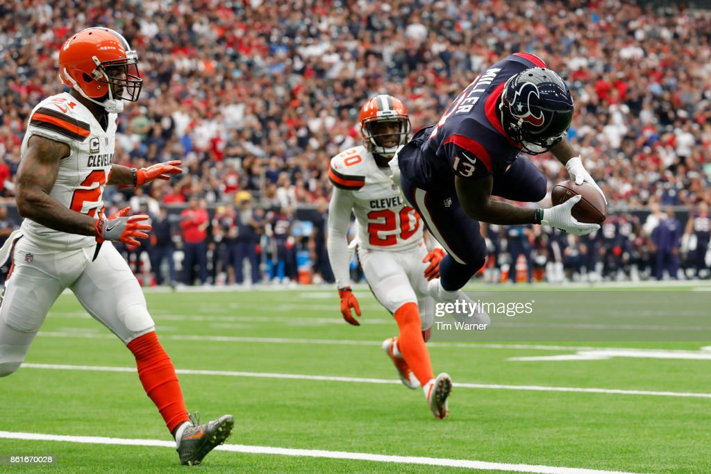 Braxton Miller #13 of the Houston Texans dives into the endzone for a touchdown in the second quarter defended by Jamar Taylor #21 of the Cleveland Browns at NRG Stadium on October 15, 2017 in Houston, Texas.