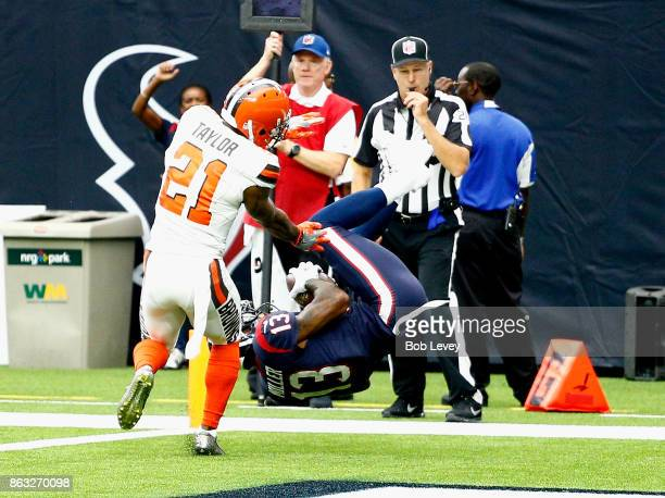 Braxton Miller of the Houston Texans flips into the end zone for a touchdown as Jamar Taylor of the Cleveland Browns is late on coverage at NRG...