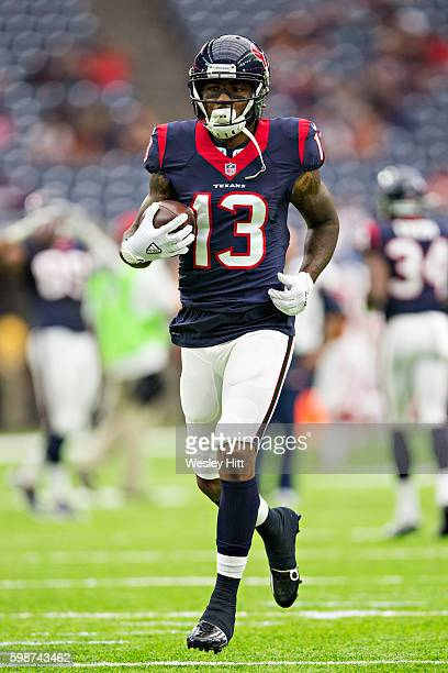 Braxton Miller of the Houston Texans warms up before a preseason game against the Arizona Cardinals at NRG Stadium on August 28 2016 in Houston Texas...
