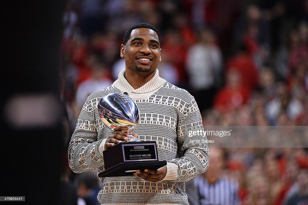 <a gi-track='captionPersonalityLinkClicked' href=/galleries/search?phrase=Braxton+Miller&family=editorial&specificpeople=7122480 ng-click='$event.stopPropagation()'>Braxton Miller</a> #5 of the Ohio State Buckeyes football team shows off his second consecutive Chicago Tribune Silver Football presented to him in the first half of the basketball game between Ohio State and the Northwestern Wildcats on February 19, 2014 at Value City Arena in Columbus, Ohio. The Silver Football is presented to the Big Ten MVP each year by the Chicago Tribune.