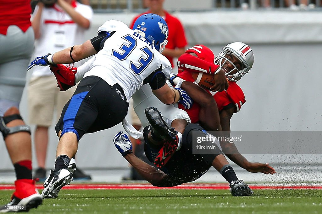 Braxton Miller #5 of the Ohio State Buckeyes is sacked by Khalil Mack #46 and Blake Bean #33, both of the Buffalo Bulls, during the third quarter on August 31, 2013 at Ohio Stadium in Columbus, Ohio. Ohio State defeated Buffalo 40-20.