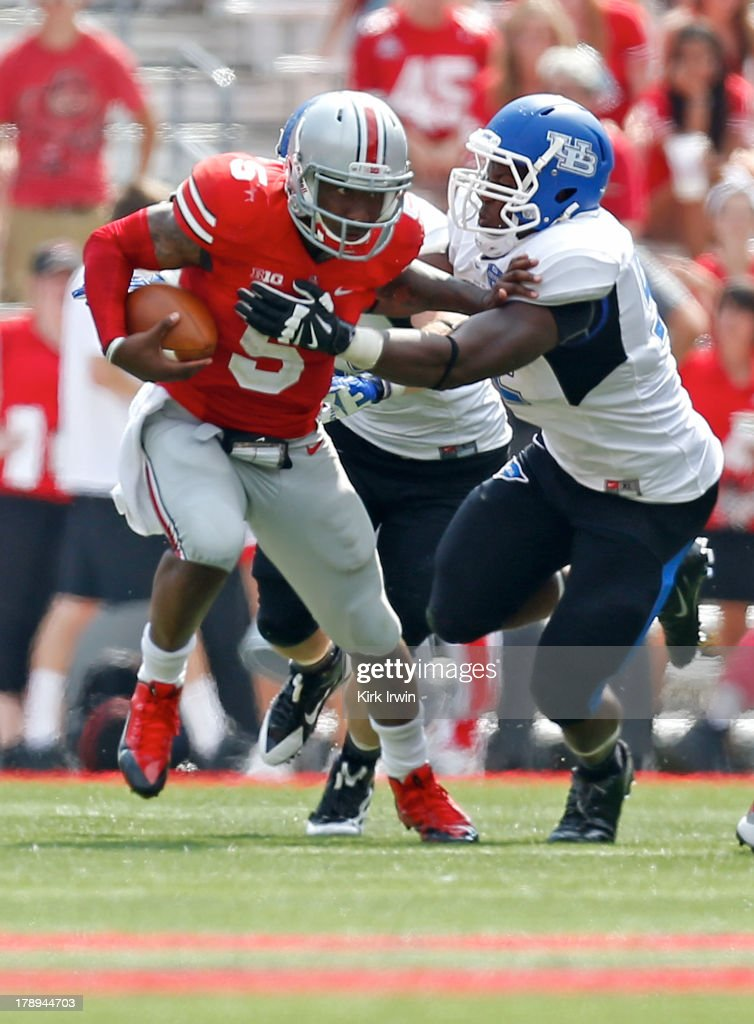 Braxton Miller #5 of the Ohio State Buckeyes is wrapped up by Tedroy Lynch #92 of the Buffalo Bulls during the fourth quarter on August 31, 2013 at Ohio Stadium in Columbus, Ohio. Ohio State defeated Buffalo 40-20.