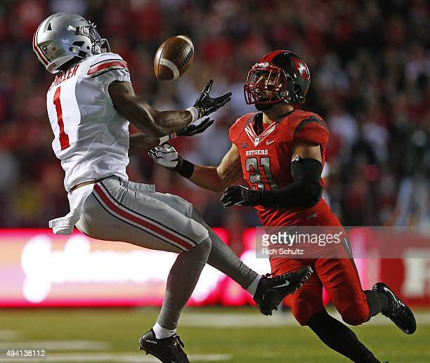 Braxton Miller of the Ohio State Buckeyes makes a catch for a first down as Anthony Cioffi of the Rutgers Scarlet Knights defends during the second...