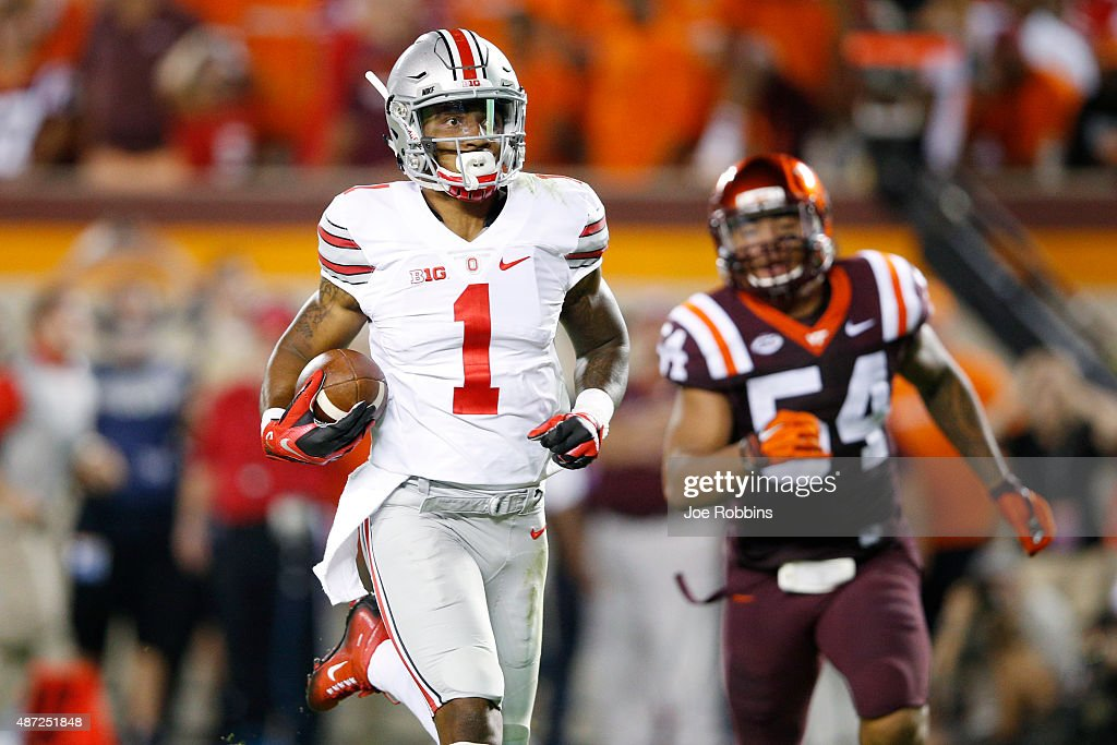 <a gi-track='captionPersonalityLinkClicked' href=/galleries/search?phrase=Braxton+Miller&family=editorial&specificpeople=7122480 ng-click='$event.stopPropagation()'>Braxton Miller</a> #1 of the Ohio State Buckeyes runs for a 53-yard touchdown in the third quarter against the Virginia Tech Hokies at Lane Stadium on September 7, 2015 in Blacksburg, Virginia.