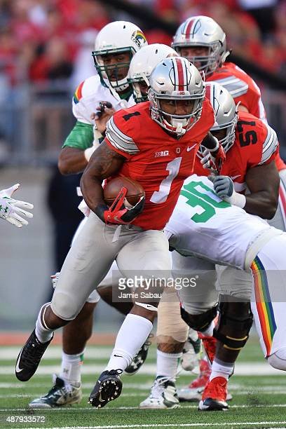 Braxton Miller of the Ohio State Buckeyes runs upfield in the fourth quarter against the Hawaii Rainbow Warriors at Ohio Stadium on September 12 2015...