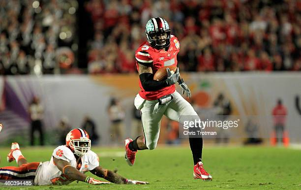 Braxton Miller of the Ohio State Buckeyes runs with the ball in the first quarter against the Clemson Tigers during the Discover Orange Bowl at Sun...