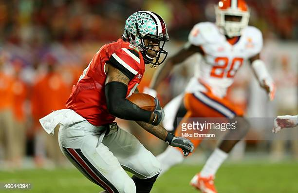 Braxton Miller of the Ohio State Buckeyes runs with the ball in the first half against the Clemson Tigers during the Discover Orange Bowl at Sun Life...