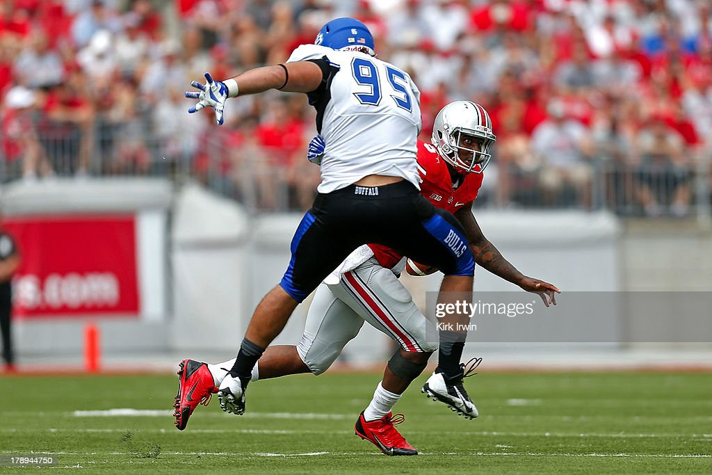 Braxton Miller #5 of the Ohio State Buckeyes scrambles past Beau Bachtelle #95 of the Buffalo Bulls during the third quarter on August 31, 2013 at Ohio Stadium in Columbus, Ohio. Ohio State defeated Buffalo 40-20.