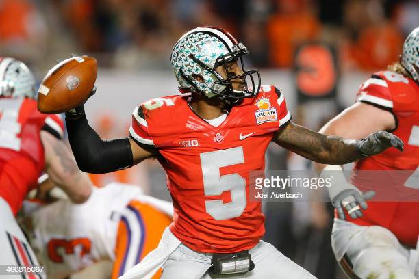 Braxton Miller of the Ohio State Buckeyes throws the ball against the Clemson Tigers during the 2014 Discover Orange Bowl at Sun Life Stadium on...