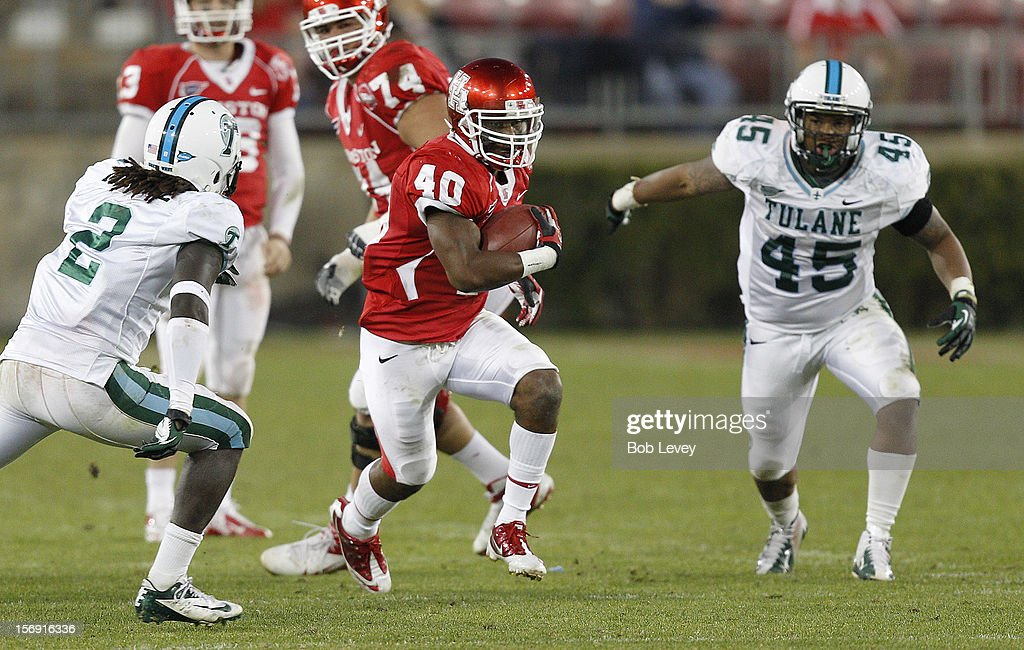 Braxton Welford #40 of the Houston Cougars rushes past Darion Monroe #2 of the Tulane Green Wave at Robertson Stadium on November 24, 2012 in Houston, Texas. Houston defeats Tulane 40-17.