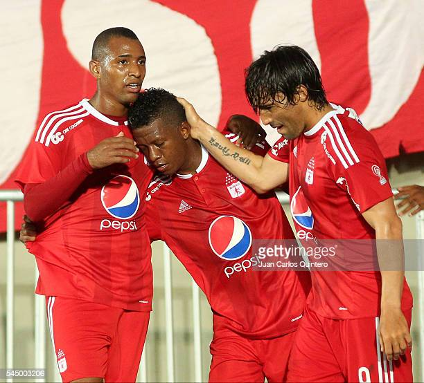 Brayan Angulo of America de Cali celebrates with teammates after scoring the opening goal during a match between Atletico FC and America de Cali as...