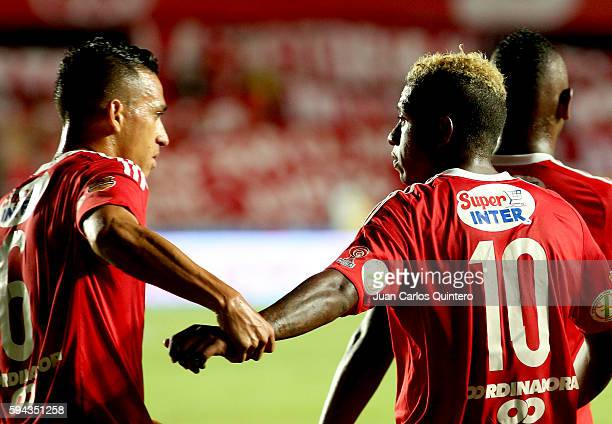 Brayan Angulo of America de Cali celebrates with teammates after scoring the third goal of his team during a match between America de Cali and...