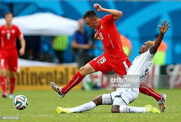 Brayan Beckeles of Honduras and Josip Drmic of Switzerland compete for the ball during the 2014 FIFA World Cup Brazil Group E match between Honduras...
