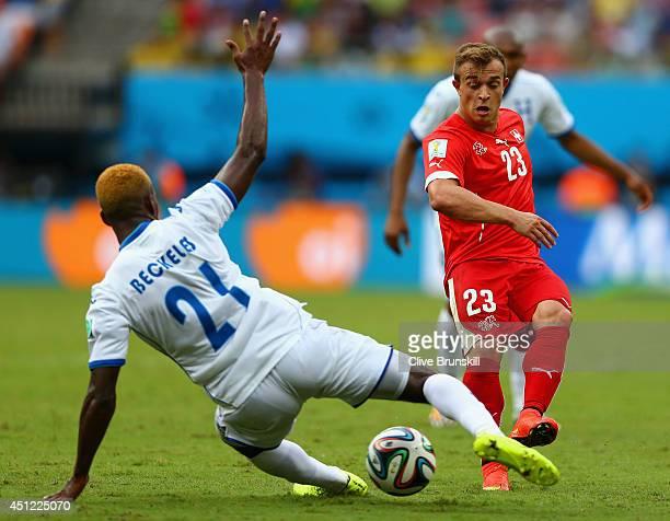 Brayan Beckeles of Honduras challenges Xherdan Shaqiri of Switzerland during the 2014 FIFA World Cup Brazil Group E match between Honduras and...