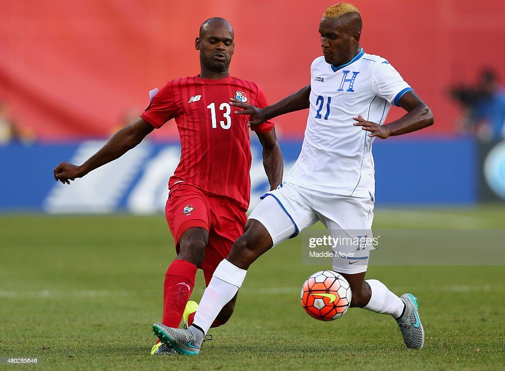 Brayan Beckeles #21 of Honduras defends Adolfo Machado #13 of Panama during the 2015 CONCACAF Gold Cup match between Honduras and Panama at Gillette Stadium on July 10, 2015 in Foxboro, Massachusetts.