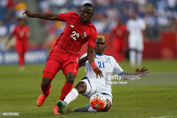 Brayan Beckeles of Honduras slide tackles Abdiel Arroyo of Panama during the 2015 CONCACAF Gold Cup match between Honduras and Panama at Gillette...