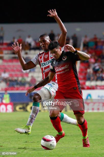 Brayan Beckeles of Necaxa fights for the ball with Gustavo Bou of Tijuana during the 2nd round match between Necaxa and Tijuana as part of the Torneo...